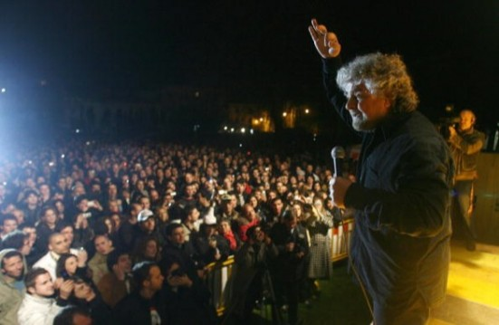Italian showman Beppe Grillo gestures as
